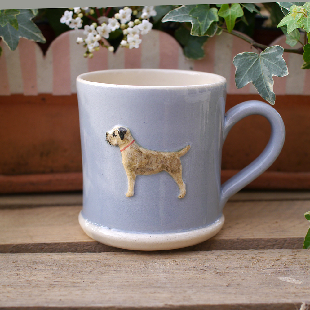 Lovely Jane Hogben Pottery Mug in Blue featuring the super popular Border Terrier design.