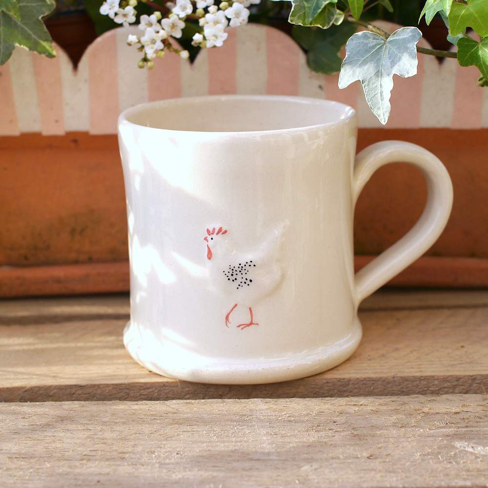 Lovely Jane Hogben Pottery Mug in cream featuring the Chicken design.