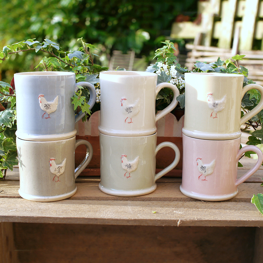 Lovely Jane Hogben Pottery Mugs in various colours featuring the Chicken design.