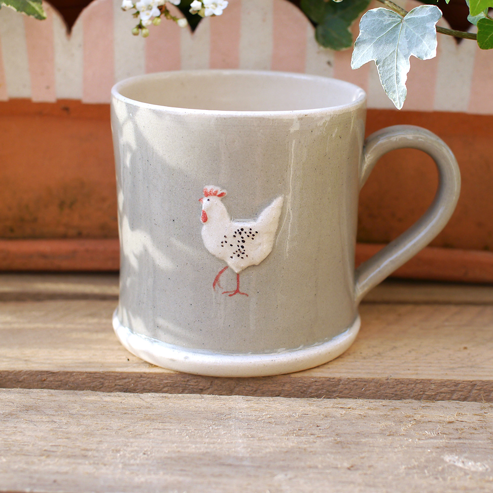 Lovely Jane Hogben Pottery Mug in Taupe featuring the Chicken design.