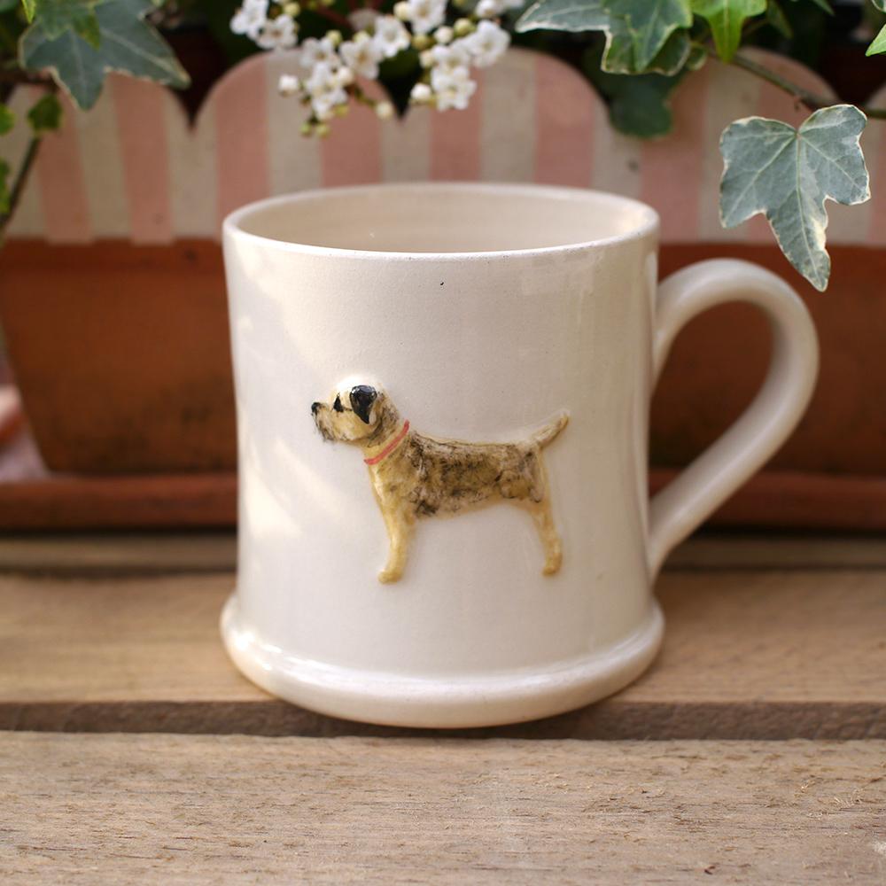 Lovely Jane Hogben Pottery Mug in Cream featuring the super popular Border Terrier design.
