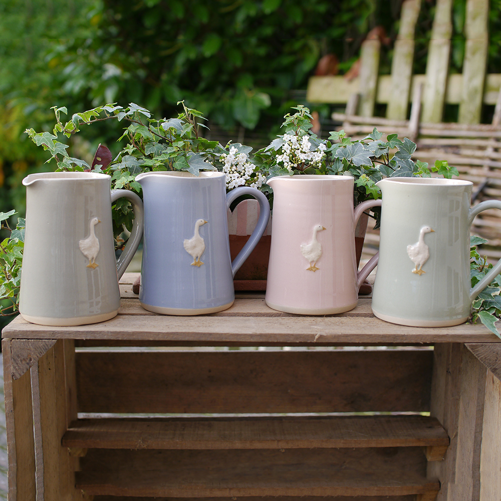 Large Jane Hogben Pottery Jugs in soft country colours featuring a charming goose design.