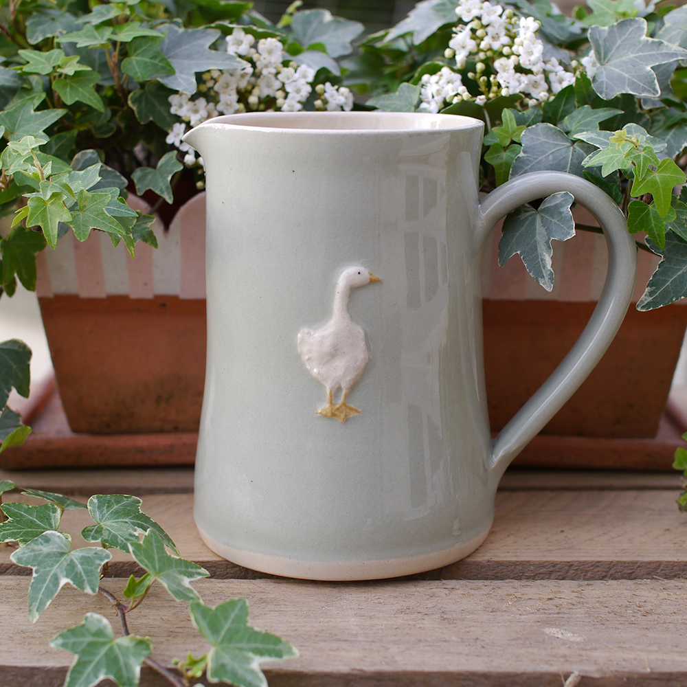 Large Jane Hogben Pottery Jug in pale green featuring a charming goose design.