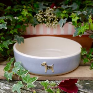 Jane Hogben dog bowl featuring a hand-painted Airedale design in blue.
