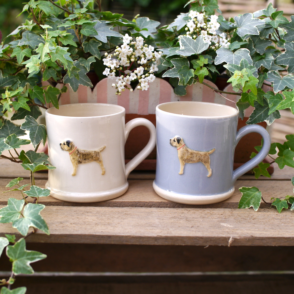 Lovely Jane Hogben Pottery Mugs in various colours featuring the super popular Border Terrier design.