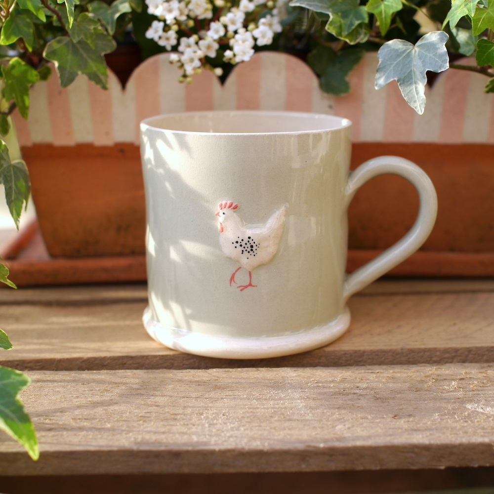 Lovely Jane Hogben Pottery Mug in Pale Green featuring the Chicken design.