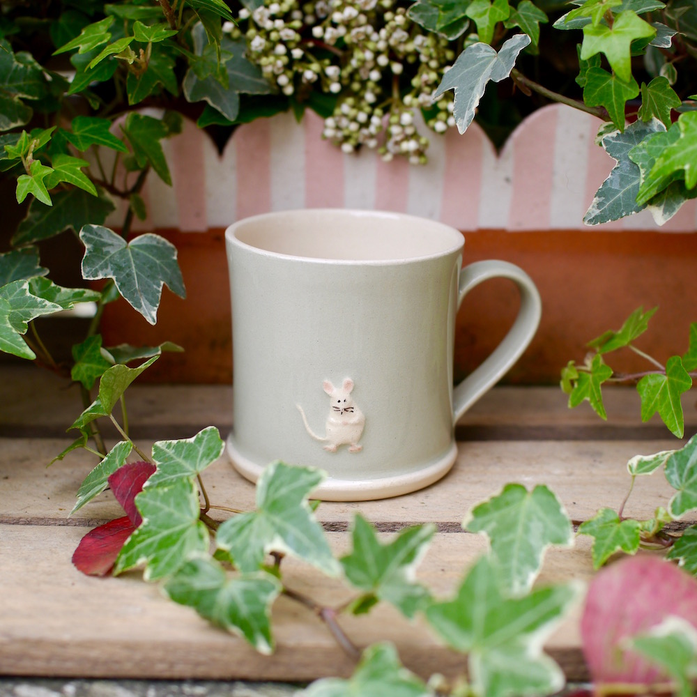 Jane Hogben Pottery Green Mug featuring a little mouse design