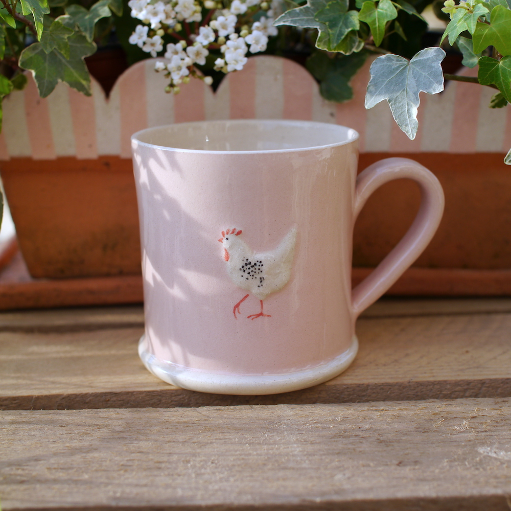 Lovely Jane Hogben Pottery Mug in Soft Pink featuring the Chicken design.