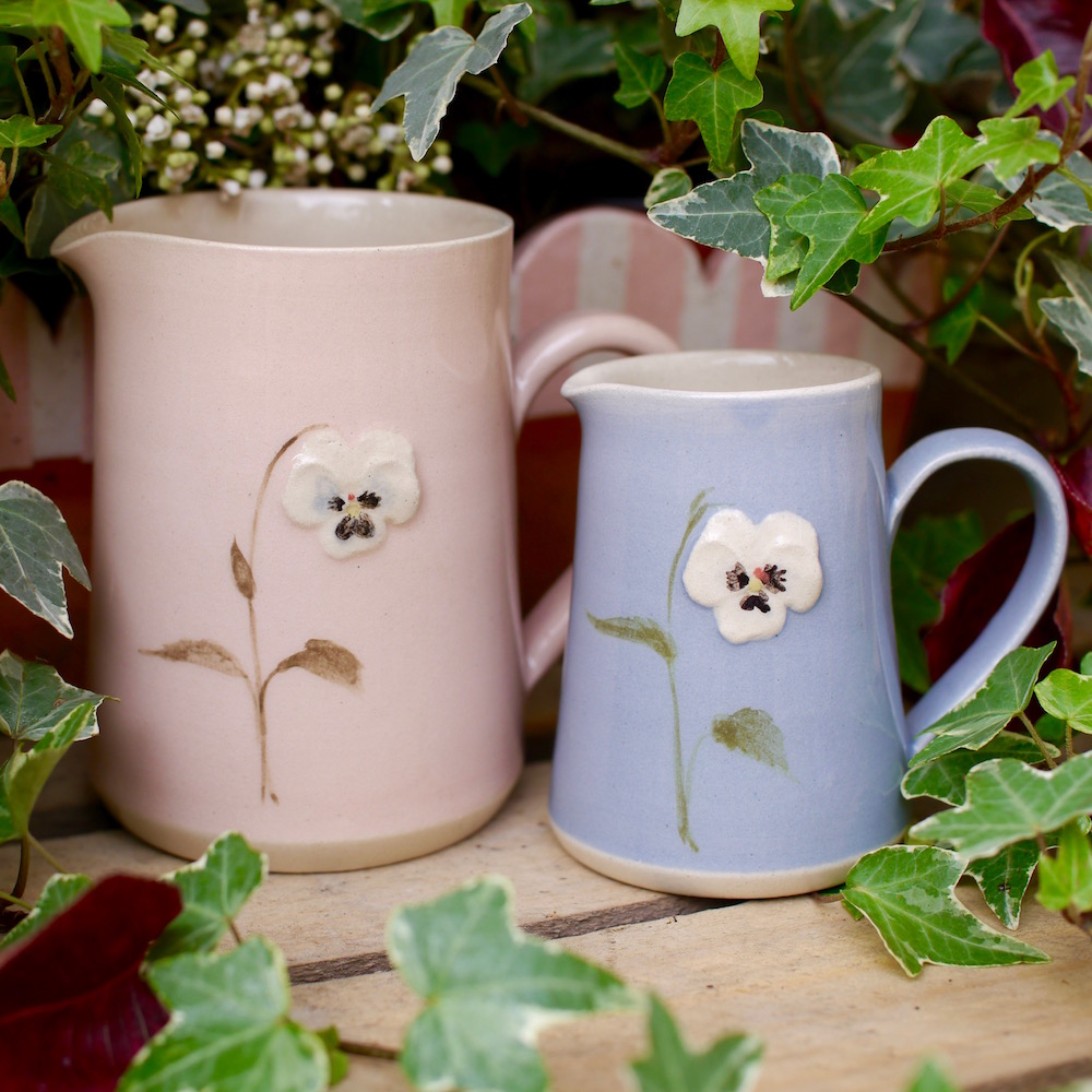 Jane Hogben Jugs featuring a Pansy design. Handmade by the Jane Hogben Pottery.