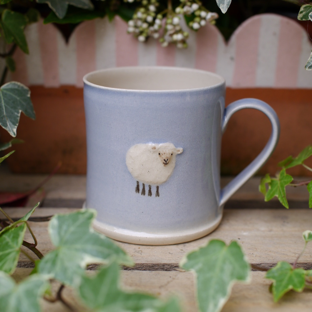 Jane Hogben Pottery espresso mug with sheep design in blue.