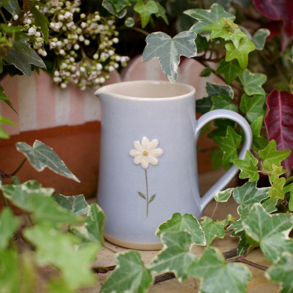 Jane Hogben Small Jug in Blue featuring a hand-painted daisy design.