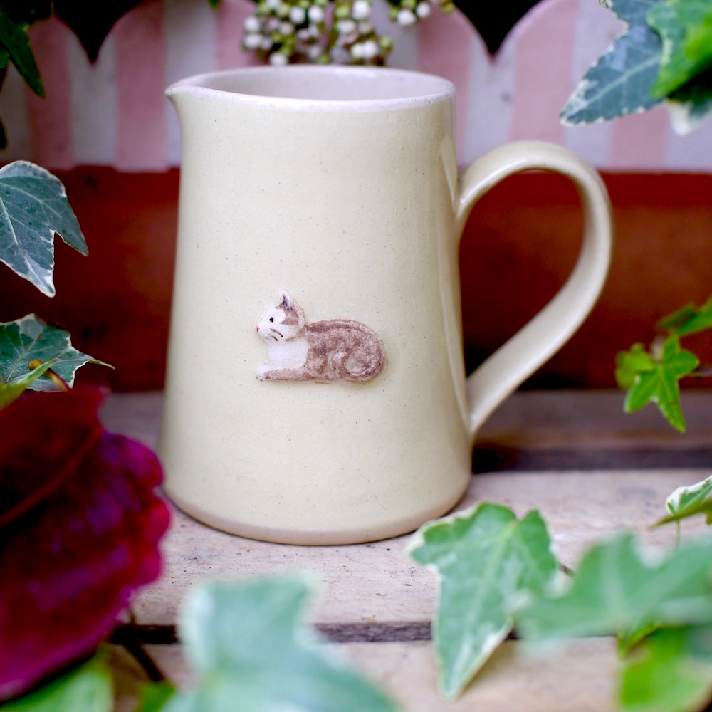 Small, Pale Yellow Jane Hogben Jug featuring a lovely little cat.