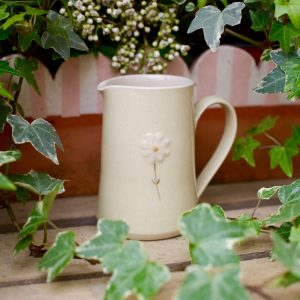 Jane Hogben Small Jug in Yellow featuring a hand-painted daisy design.