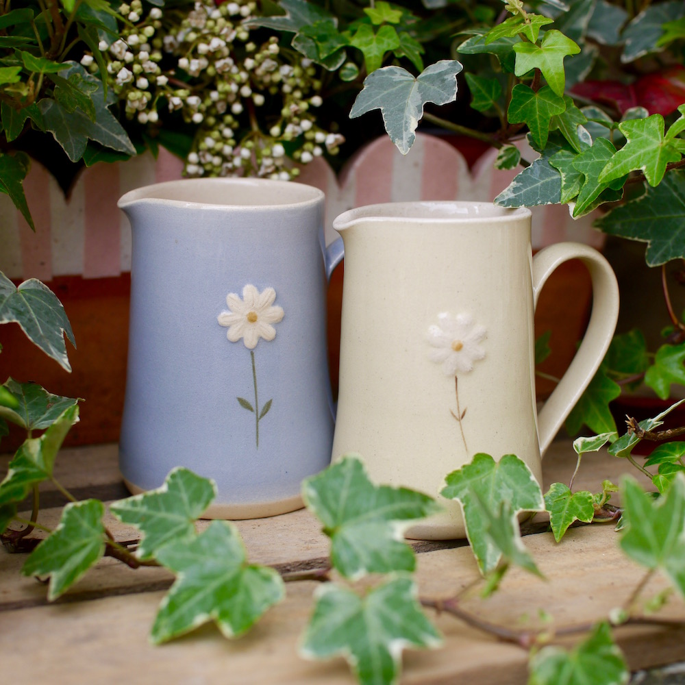 Jane Hogben Small Jugs in Blue and Pale Yellow featuring a hand-painted daisy design.