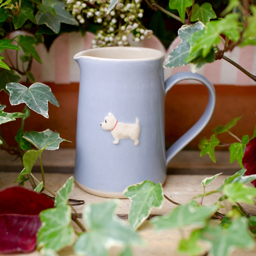 Small, blue Jane Hogben Jug featuring a charming little Westie design.