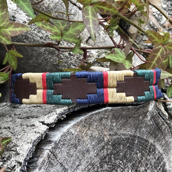 A smart design, British racing green, navy and beige with a thin red stripe