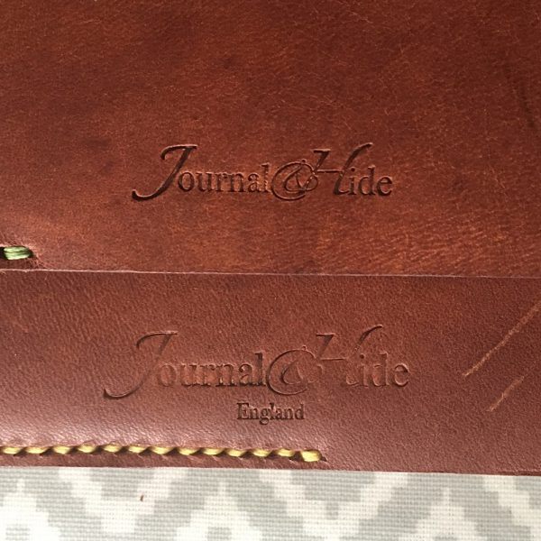 The distinctive Journal & Hide stamp