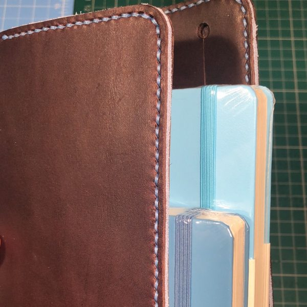 Journal & Hide A5 Journal Cover: Chocolate leather, Powder Blue Stitching. Powder Blue Suede Sandwich. Top notebook: Ice Blue, bottom notebook: Nordic Blue.