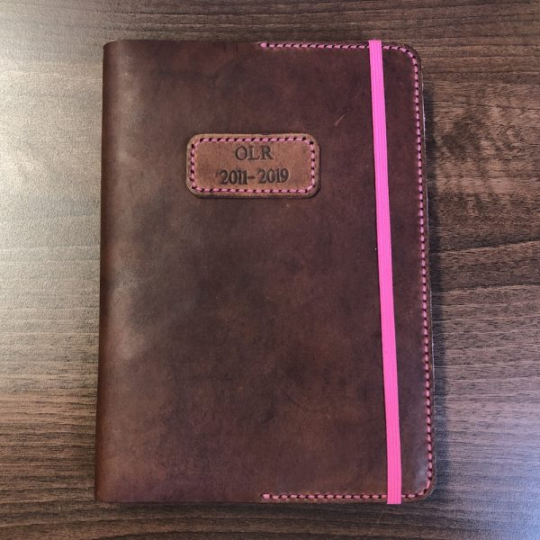 Journal & Hide A5 Journal Cover Mid Tan Pink Stitching. Patch on the front an optional extra.