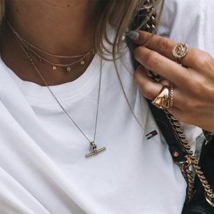 Tilly Sveaas gold T-bar and trace chain